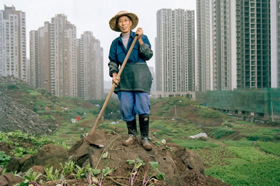 As Jiangbei rises into a forest of high-rises, shopping malls, and elevated roads, lifelong resident Ren Yindi, 66, continues to farm. (Tim Franco)